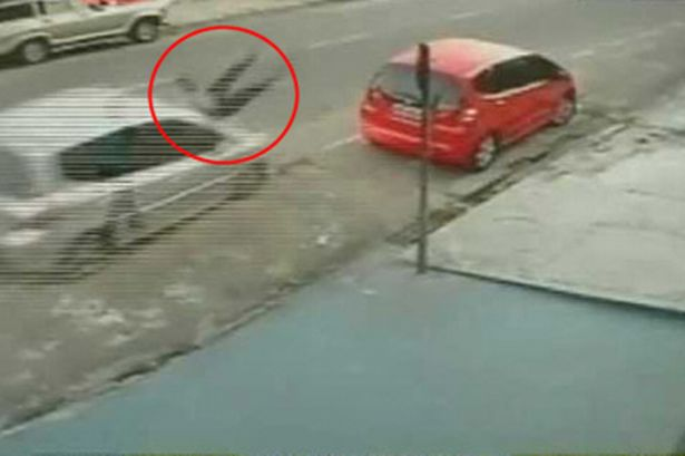 woman-hit-by-a-car-in-brazil-284985478